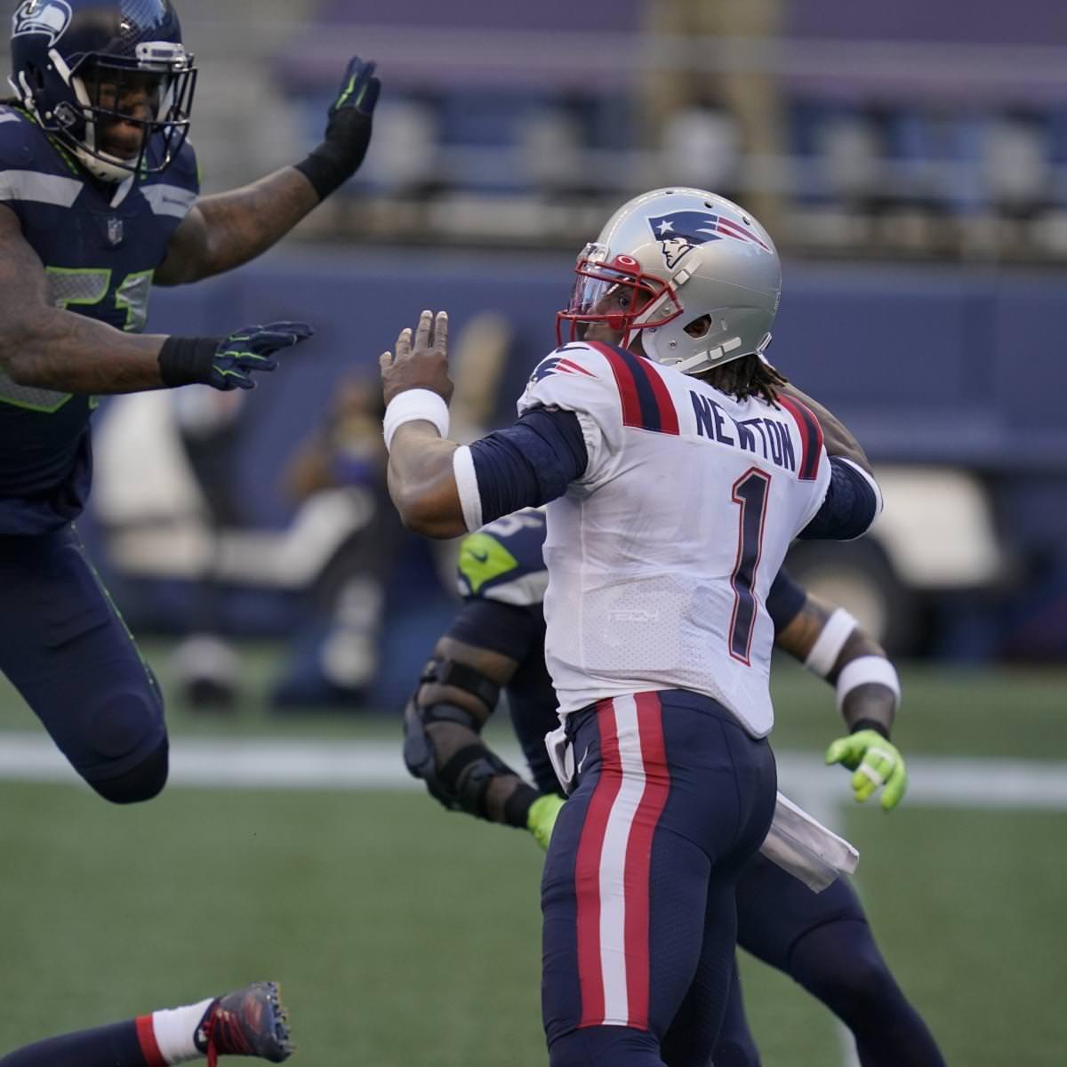 Bruce Irvin, do Seahawks, multado em US $ 20 mil por hit no Cam Newton do Patriots na semana 2